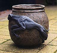 An earthenware pot with Greyhound